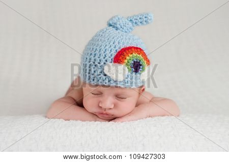 Newborn Baby Boy Wearing A Rainbow Hat