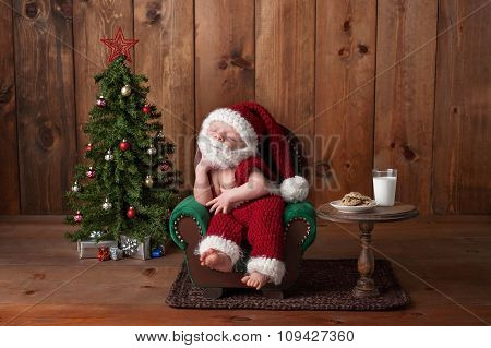 Newborn Baby Boy Wearing A Santa Suit With Beard