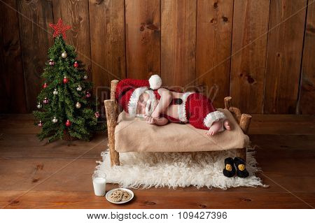 Sleeping Newborn Baby Boy Wearing A Santa Suit With Beard
