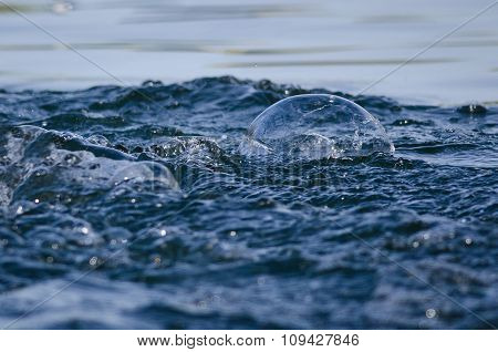 Nature Abstract: Bubble Floating In Turbulent Blue Water