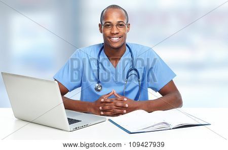 African-American black doctor man over hospital background.