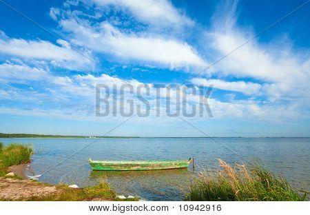 Boat On Summer Lake Bank