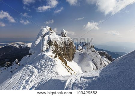 Alpine panorama with snow covered cliffs