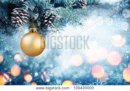 Golden Bauble Hanging Fir Branch With Snowfall