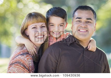 Happy Attractive Young Mixed Race Family Portrait Outdoors.