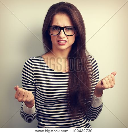 Nervous Angry Young Woman In Glasses With Aggressive Negative Face Showing Fists