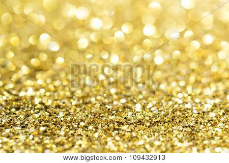 Gold abstract glitter background with copy space