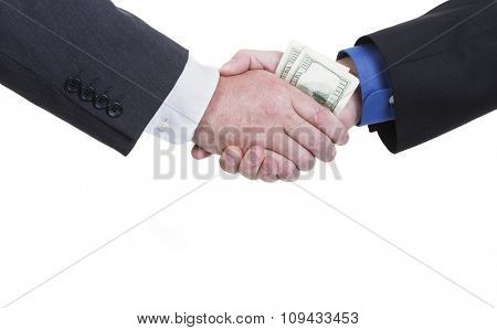 A business handshake with money being exchanged on a white background with copy space.