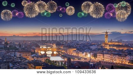 Beautiful fireworks under Arno River and Ponte Vecchio at sunset, Florence