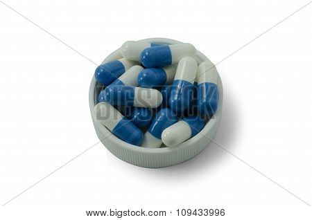 Some Pills Of A White And Blue Colors With White Cap