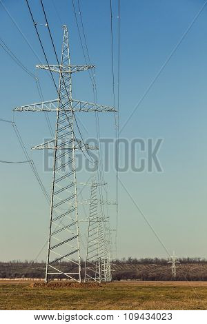 Power lines that passes through the fields