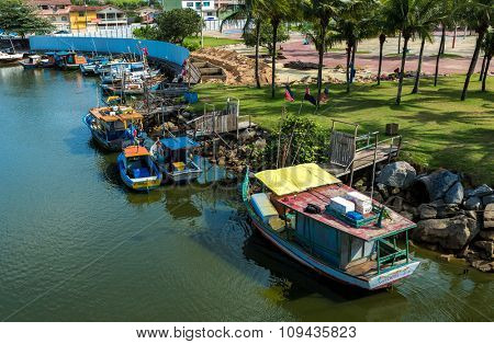 VITORIA, BRAZIL - CIRCA JULY 2015: Aged rowboat on the water from an old fishing village in Espirito Santo, Brazil