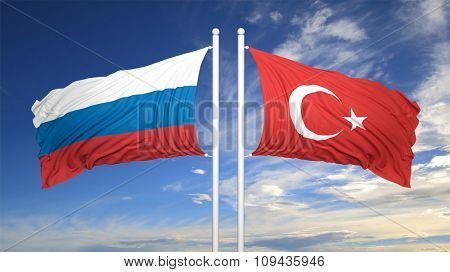 Turkish and Russian flags against of blue sky