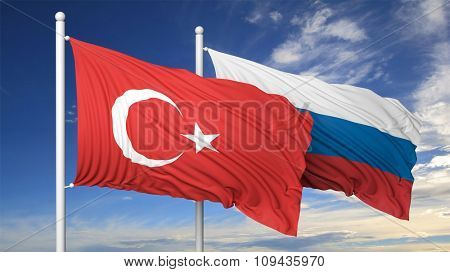 Turkish and Russian flags against of blue sky.