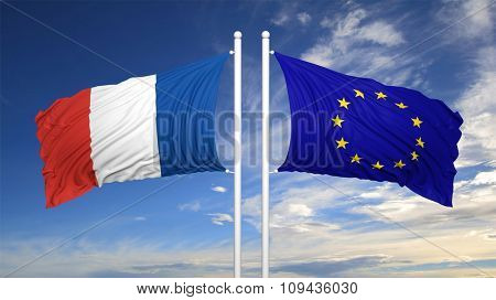 French and EU flags waving against of blue sky