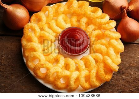 Chips rings with sauce on plate closeup