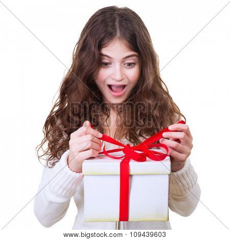 Portrait of cute cheerful teen girl receiving gift, excited facial expression, isolated on white background, celebrating Christmas holidays