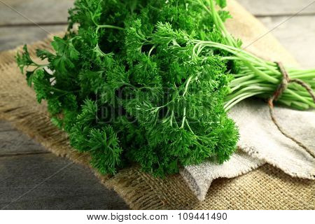 Fresh parsley on sackcloth napkin
