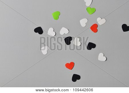 Tiny heart-shaped pieces of paper scattered all over. UAE national day celebration background.