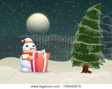 Cute Snowman holding glossy gift with Xmas Tree on winter night background for Merry Christmas celebration.