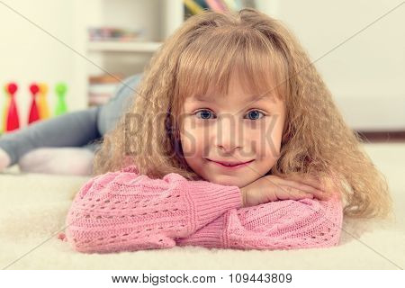 Portrait of a beautiful smiling little girl in the children's room