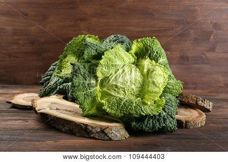 Savoy cabbage on cutting board closeup