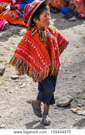 Quechua Boy With Hat In A Village In The Andes, Ollantaytambo, Peru