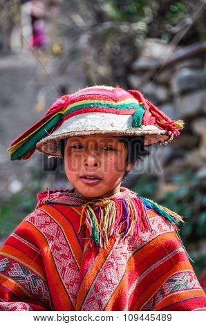 Quechua Boy In Hat In A Village In The Andes, Ollantaytambo, Peru