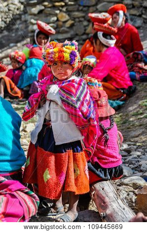 Quechua Girl And Family In A Village In The Andes, Ollantaytambo, Peru