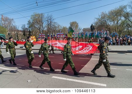 Cadets of patriotic club go on parade with flag