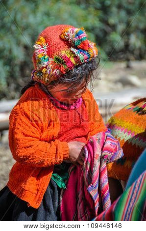 Shy Quechua Girl In A Village In The Andes, Ollantaytambo, Peru