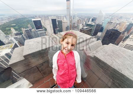 Girl on roof of a skyscraper with reflection in the form of wings