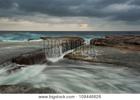 Cloudy Seascape With Flowing Water
