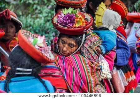 Quechua Woman In Colorful Hat In A Village In The Andes, Ollantaytambo, Peru