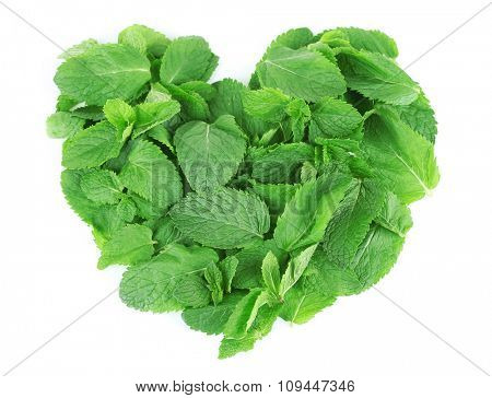 Heart shaped pile of mint isolated on white