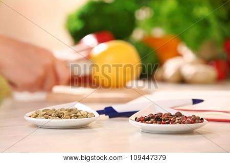 Variety of spices in ceramic containers on the kitchen table