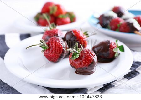 Served table with delicious strawberries in chocolate