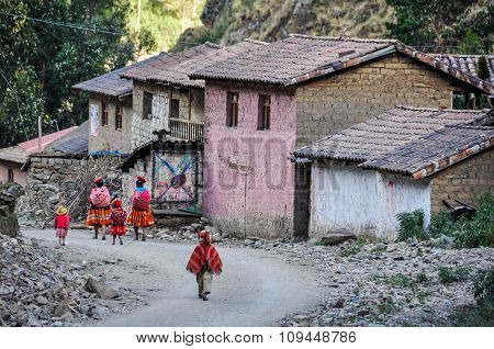Quechua Family Going Home In A Village In The Andes, Ollantaytambo, Peru