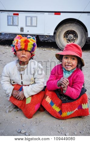 Quechua Girls Playing In A Village In The Andes, Ollantaytambo, Peru