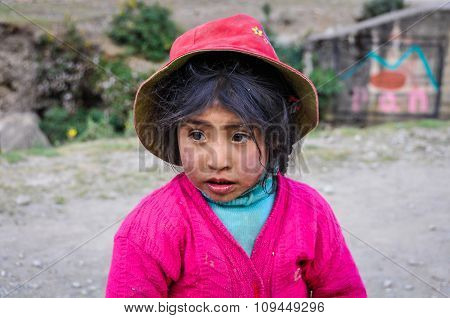 Quechua Girl Staring In A Village In The Andes, Ollantaytambo, Peru