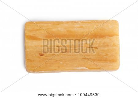 Piece of brown soap isolated on white background