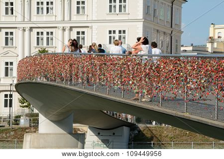 Pedestrian Bridge With Thousands Of Padlocks On Barrier.