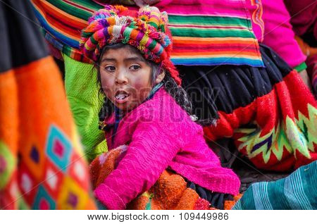 Quechua Girl Chewing Something In A Village In The Andes, Ollantaytambo, Peru