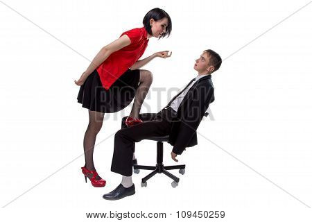 Woman and man sitting in black suit