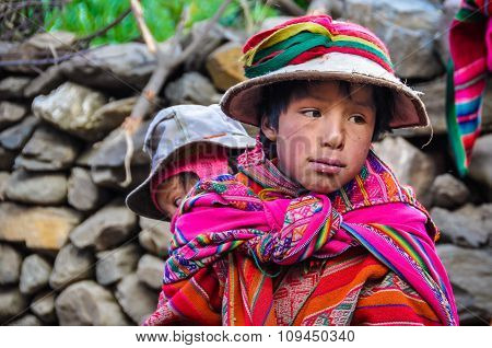 Quechua Boy With Sister In A Village In The Andes, Ollantaytambo, Peru