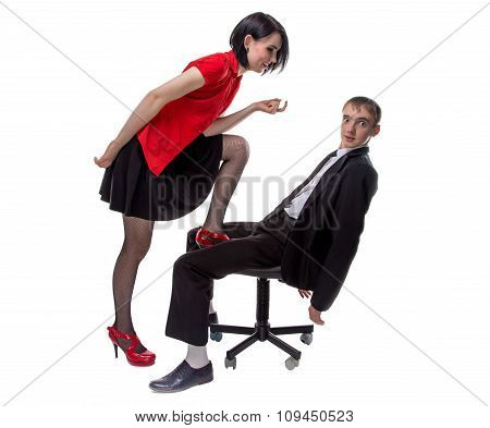 Woman in red and man sitting