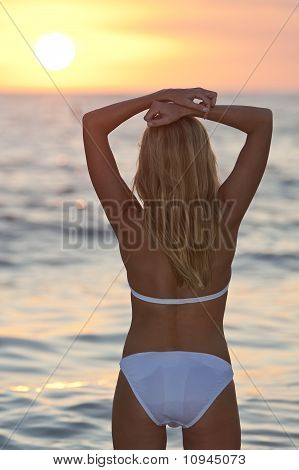 Beautiful Woman In Bikini On Beach At Sunset