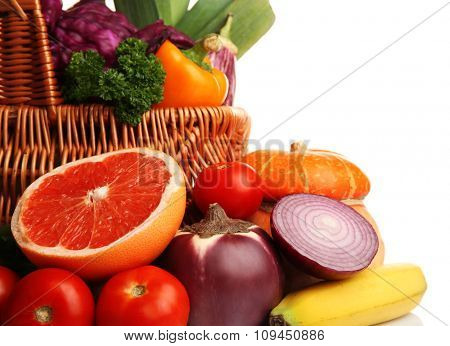Juicy fruit and tasty vegetables isolated on white