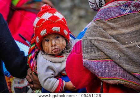 Quechua Baby Looking In A Village In The Andes, Ollantaytambo, Peru