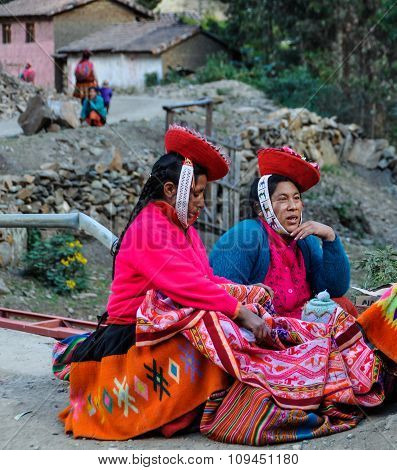 Quechua Women In Colorful Dress In A Village In The Andes, Ollantaytambo, Peru